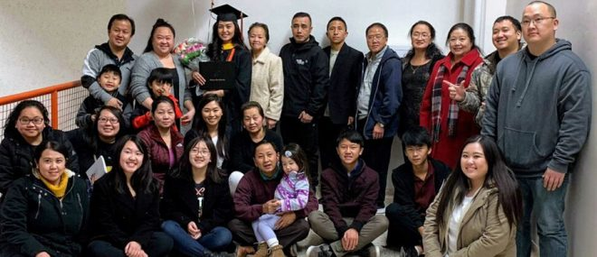 Chee Her with her family celebrating her graduation.