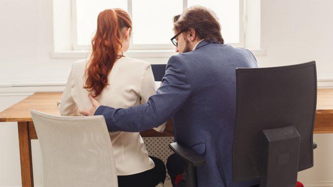 male employee harassing female coworker