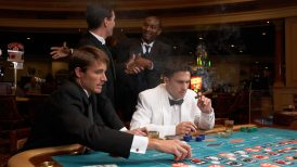Four men playing roulette at a casino