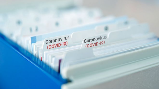 File folders labeled with COVID-19