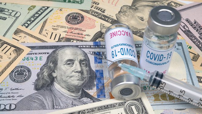 COVID-19 vaccine vials laying on money