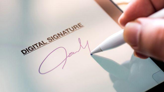 person signing an iPad using a digital signature