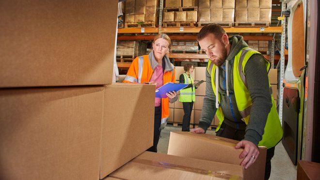 Employees loading vehicle