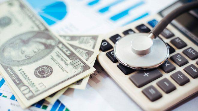 Money on top of healthcare paperwork