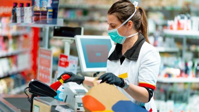 Grocery store worker with face mask