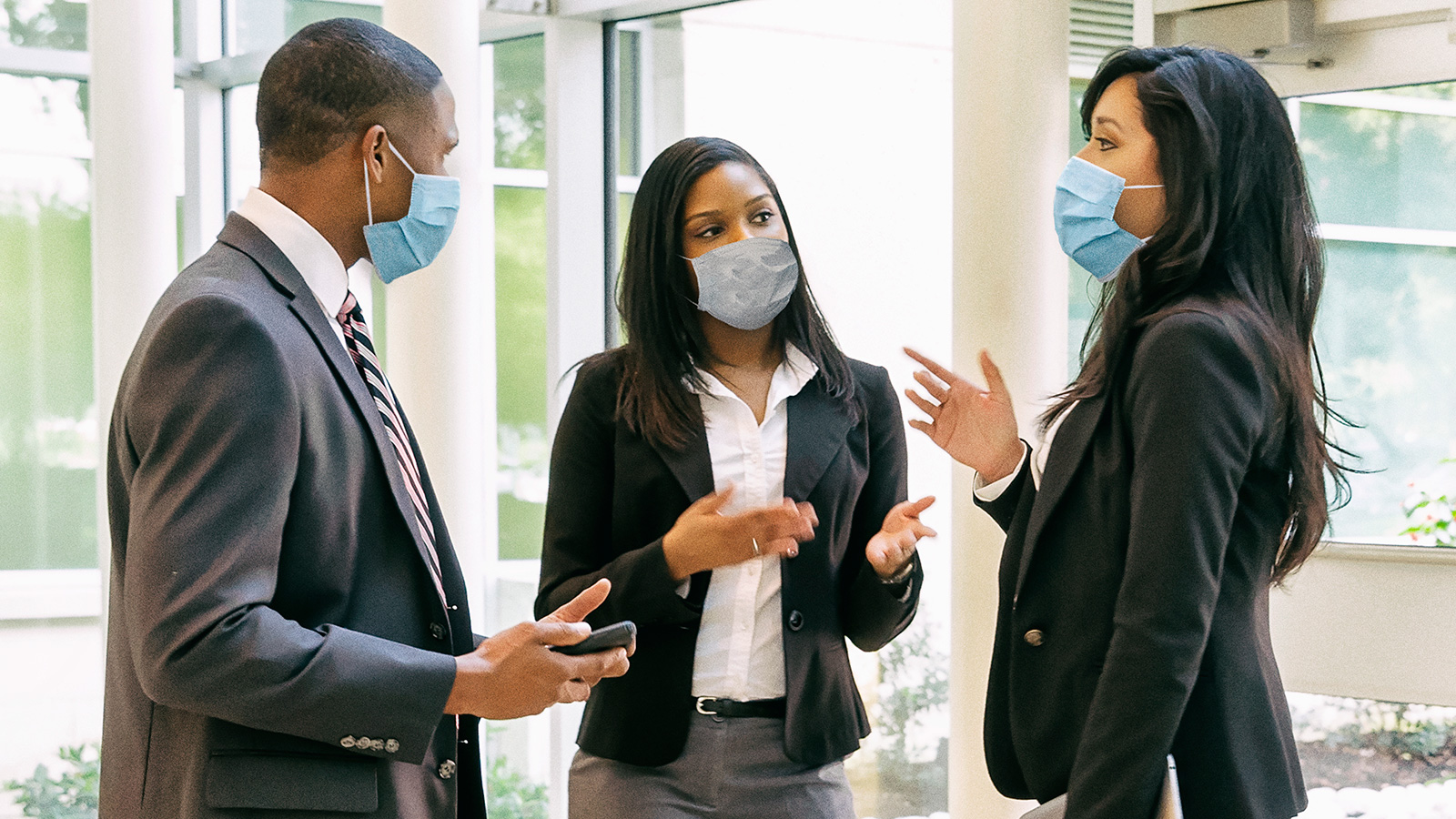 Business people talking while wearing face masks