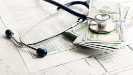 Money with a doctor's stethoscope