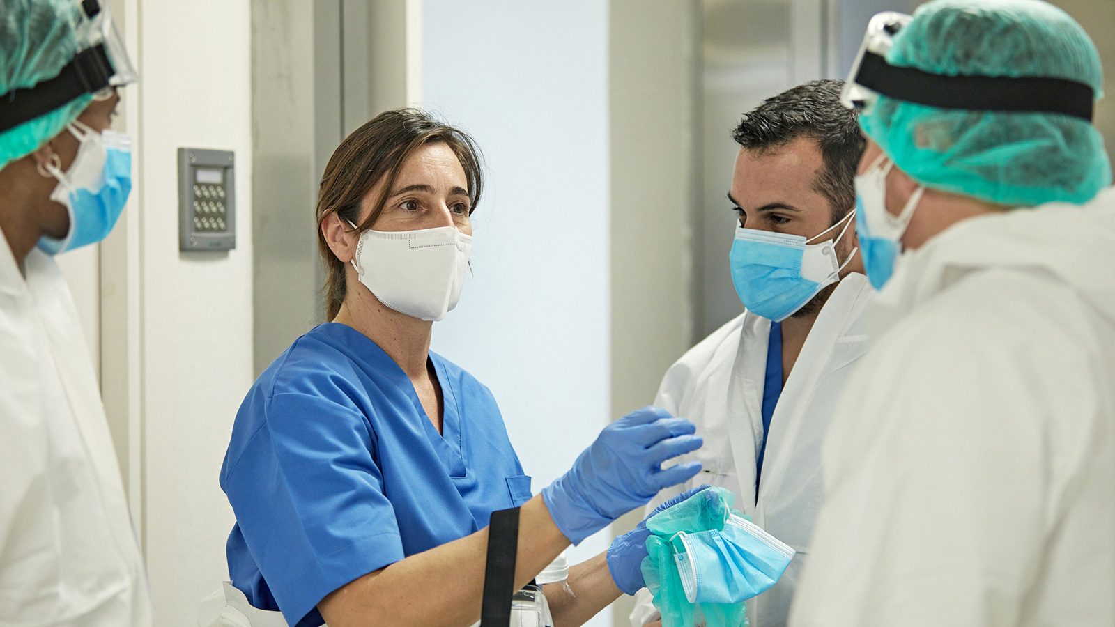 Healthcare workers talking while wearing masks