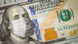 Hundred dollar bill altered with face mask