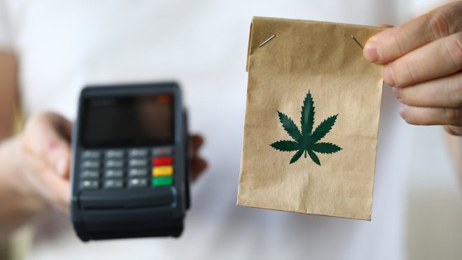 Package with marijuana symbol and payment terminal