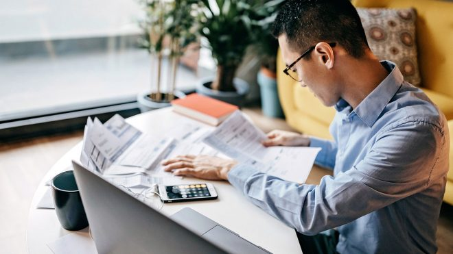 Man reviewing documents at work