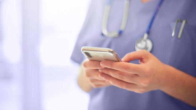 Nurse texting on a phone