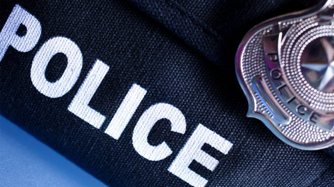 police badge and vest