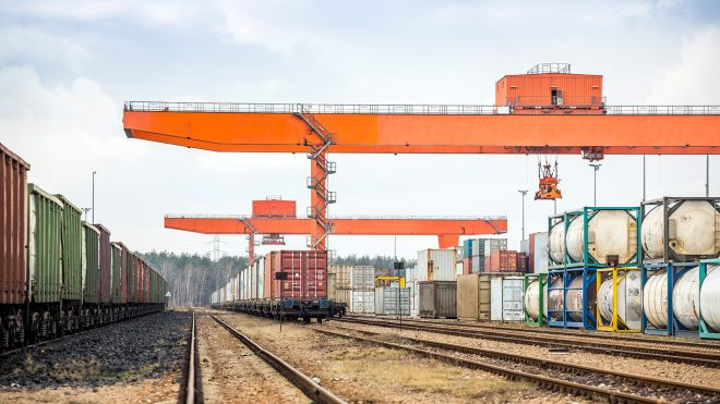Rail yard with crane in background