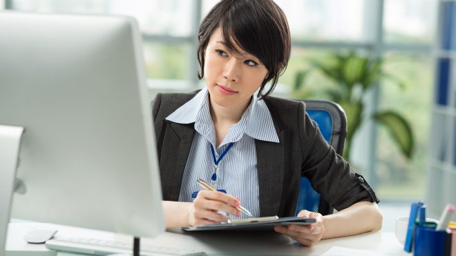 Young employee working at her computer