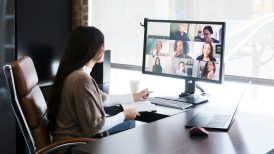 Woman meeting with her coworkers via video