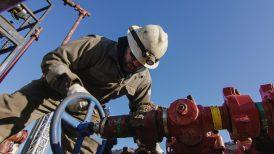 An Oilfield Worker in His Thirties Pumps Down Line