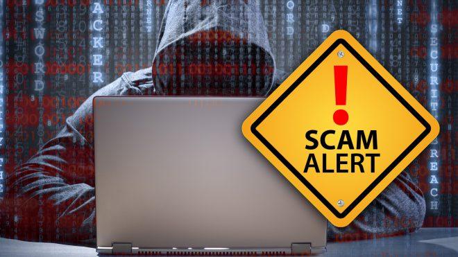 Scam alert - hacker looking over computer files