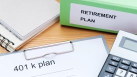 401K and retirement documents on a table