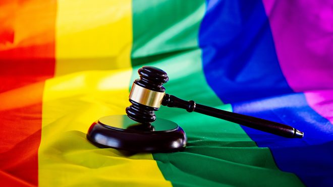 Gavel with LGBT flag background