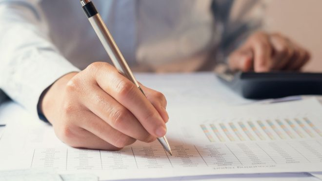Business owner reviewing tax code