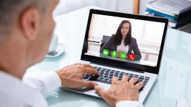 Man and woman on a video conference call