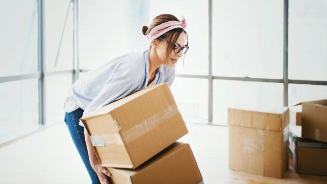 Woman lifting boxes