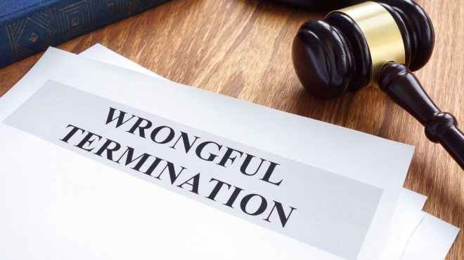Wrongful termination document on a desk